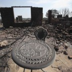 A home destroyed by fire in a area overrun by the blaze at Possum Kingdom Lake. (AP Photo/LM Otero)