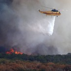 A helicopter drops water on a wildfire at Possum Kingdom Lake, Texas, last week. (AP Photo/LM Otero)