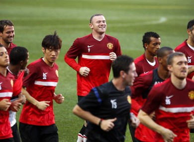 Rooney and teammates at Benfica's Luz stadium in Lisbon last night.