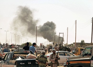 The battle between revolutionary fighters and Gaddafi loyalists continues along the roads of Sirte.