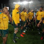 A dejected Australia prepare to leave the pitch. <span class=