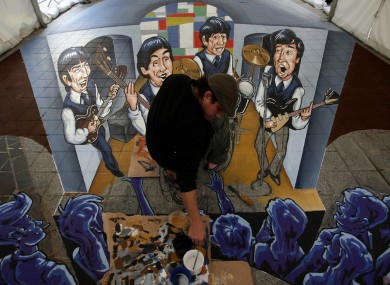 3D street painter Juandres Vera from Mexico works on his image of The Beatles in Liverpool.