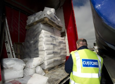 File photo of a Customs officer at a fuel laundering plant.