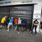 Rating agency Standard and Poors has said that the financial profiles of National Bank of Greece, EFG Eurobank, Alpha Bank and Piraeus Bank are exposed to significantly heightened risks. Image: AP Photo/Kostas Tsironis