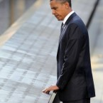 Obama touches the names etched into the memorial wall during his visit to the North Memorial Pond at the National September 11 Memorial. 