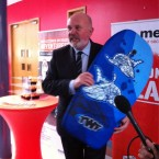 He sang the National Anthem at DCU - if he wins the competition, he gets this surf board. Image: @SenDavidNorris