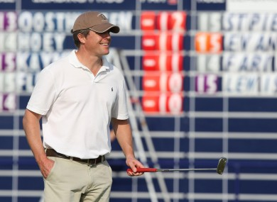 Actor Hugh Grant warms up at the Alfred Dunhill Links Championship on Friday.