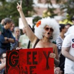 A woman chants during an Occupy Boston demonstration on the plaza in front of the Federal Reserve Bank in Boston on Saturday. (AP Photo/Michael Dwyer/PA)