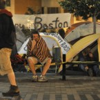 A demonstrator sits at the edge of the Occupy Boston tent village in Boston early this morning. (AP Photo/Josh Reynolds/PA)
