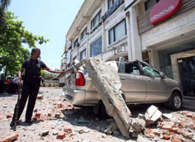 A mnivan in Kuta, Bali crushed by falling concrete during the earthquake.
