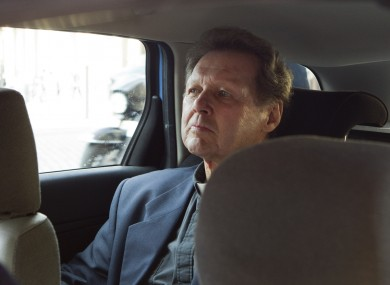 Roy Bourgeois sits in police car in a police car after being detained in Rome following his demonstration in favour of female ordination.