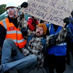A protester is carried off the illegal travellers site at Dale Farm, Essex. (Chris Radburn/PA Wire)