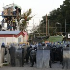 Police gather to start evictions from Dale Farm, near Basildon, 30-miles west of London, where supporters have clashed with bailiffs and riot police as the authorities work to evict illegal travelers from the site, Wednesday Oct. 19, 2011. Following a decade-long row over unauthorised properties built on the former scrap yard, Dale Farm, and various legal challenges, evictions started Wednesday. (AP Photo / Matt Dunham/PA)