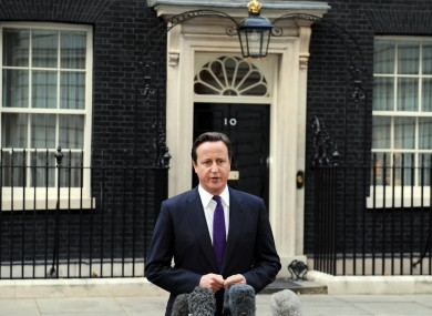 British PM David Cameron speaking to the media outside Downing Street today.