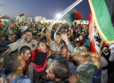 Libyans celebrate at Saha Kish Square in Benghazi, after the National Transitional Council declared the country's liberation from the rule of Muammar Gaddafi.