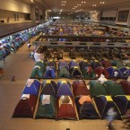 Evacuees from floodwaters rest in tents at an evacuation center inside Don Mueang Airport in Bangkok yesterday. (AP Photo/Altaf Qadri)