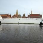 Tuk tuk taxi driver push his car in front of Grand palace in Bangkok (AP Photo/Str)