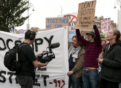 Demonstrators attend the Occupy Dame Street solidarity rally in Dublin today.