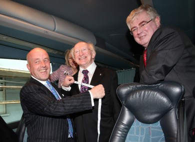If the suit fits... Michael D got fitted for a swish new suit by tailor Louis Copeland on his campaign bus last weekend. It will get a good airing now...