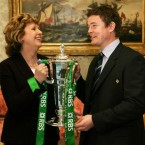Irish Rugby captain Brian O'Driscoll shows President Mary McAleese the RBS Six Nations Championships Trophy as she hosted a reception for the Grand slam winning team at Aras an Uachtarain in Dublin in 2009.