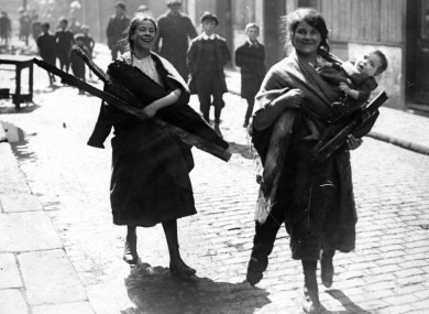 Children carrying firewood salvaged from the ruins of Sackville (now O'Connell) Street in the 1916 Rising.