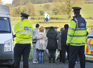 Gardaí and relatives of Ciarán Noonan at the scene his remains were discovered in Co Meath.