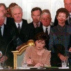 President Mary McAleese signs an Inauguration document at Dublin Castle on 11 November 1997.  (Photo by Brian Little/PA)