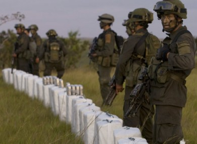Colombian police stand guard over seized packages of cocaine in Puerto Gaitan, Colombia on 13 October 2011.