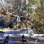 A snowplough truck backs away from a street blocked by downed power lines in North Andover, Massachusetts (AP Photo/Elise Amendola)