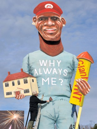 Frank Shepherd of the Edenbridge Bonfire Society puts the finishing touches to this year's celebrity guy, a giant effigy of Manchester City striker Mario Balotelli today.
