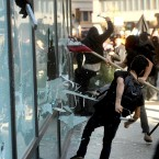 Protesters smash windows at a Wells Fargo bank branch during the Occupy Oakland march. (AP Photo/Noah Berger)