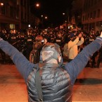 An Occupy protester shows peace signs to Oakland Police officers. (AP Photo/Jeff Chiu)