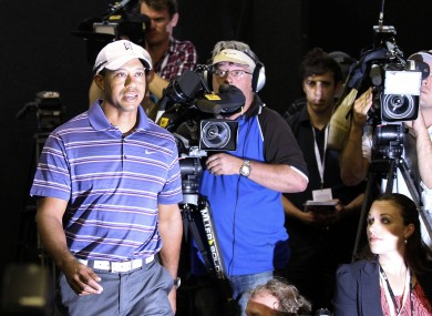 Tiger Woods arrives at the press conference in Australia earlier.