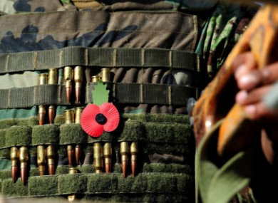 A poppy and bullets on a soldier's jack at British and Afghan troops marked Armistice Day for the first time together today.