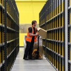 An employee moving parcels at the Fife centre (Andrew Milligan/PA Wire/Press Association Images)