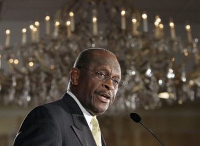 GOP candidate Herman Cain speaking to supporters at a rally on Thursday.