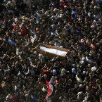 Egyptians at Tahrir Square carry the body of a protester killed in clashes with the Egyptian riot police during his funeral today. (AP Photo/Khalil Hamra/PA Images)