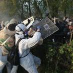 Activists and riot police clash. (AP Photo/David Vincent/PA Images)