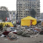 Egyptian protesters wake this morning after spending the night in Tahrir Square in Cairo. (AP Photo/Mohammed Abu Zaid)