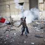 A protester points to an incoming tear gas canister during clashes with Egyptian riot police, not pictured, near Tahrir square in Cairo. (AP Photo/Tara Todras-Whitehill/PA Images)