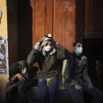 Protesters take a break during clashes with Egyptian riot police near Tahrir Square today. (AP Photo/Tara Todras-Whitehill/PA Images)