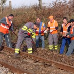 Railway workers repair a rail damaged by protesters at the tracks near Lieusant.(AP Photo/David Vincent/PA Images)