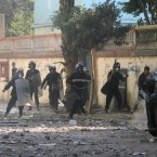 Riot policeman clash with protesters near Tahrir Square for a fifth day today. (AP Photo/Khalil Hamra/PA Images)