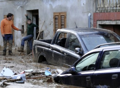 Cars are stucked in the mud in Scarcelli Saponara near Messina today.