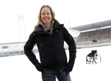 van der Vorst stands in front of her wheelchair at the Olympic Stadium in Amsterdam.