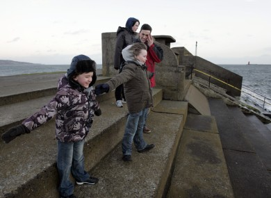The Licken family - Cormac, Rory, Colm and Aiden - from Raheny braving the wind at Dollymount in Dublin today. Met Eireann has issued a gale warning for the country.