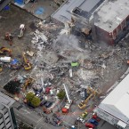 An aerial view of emergency crew working at the ruined CTV building in central in Christchurch, New Zealand on 23 February, 2011. (AP Photo/Sarah Ivey/PA Images)