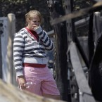 Laura Clements surveys her family's destroyed home in Bastrop, Texas in early September 2011. Over 1,000 homes were destroyed by the wildfires. (AP Photo/Eric Gay/PA Images)