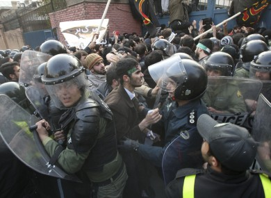 Iranian protesters scuffle with police officers as they try to enter the British Embassy, in Tehran, Iran, Tuesday, Nov. 29, 2011