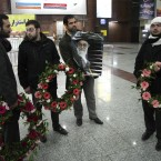 A group of demonstrators wait to welcome Iranian diplomats expelled from London at Tehran's Mehrabad airport. (AP Photo/Vahid Salemi/PA Images)